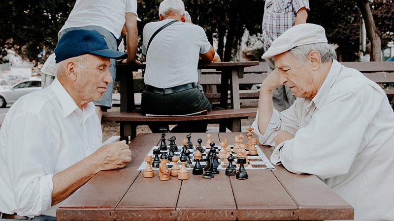 Elders playing chess